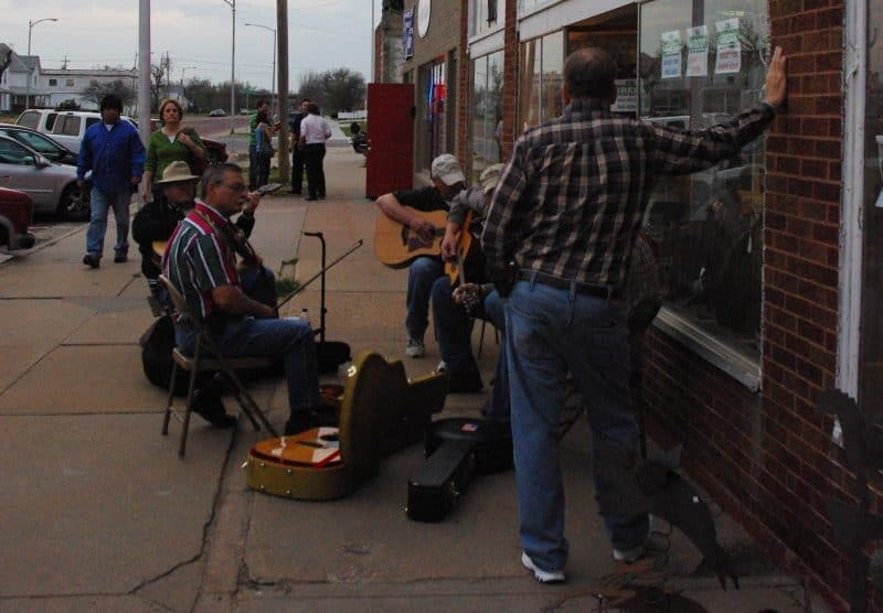 Sidewalk musicians draw customers to businesses spread all over downtown. Photo by Becky McCray.