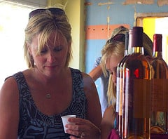 Woman tries a wine sample.