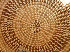 Spiral pattern on the bottom of a basket. Photo Creative Commons licensed by Muffet.