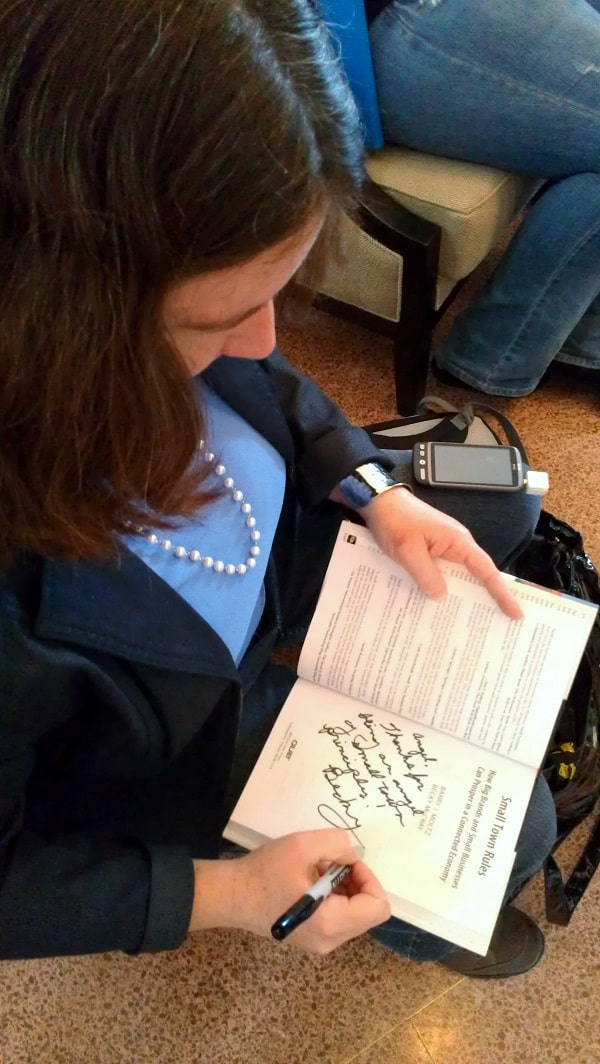 Signing my book at Social Media Tulsa Conference, after accepting payment via Square.