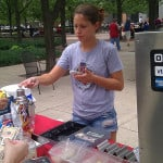 Mobile hot dog vendor accepts a credit card payment with a Square reader.