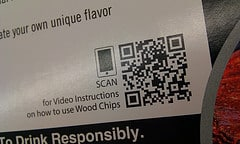 "QR code with caption, ""scan for video instructions on how to use wood chips."""