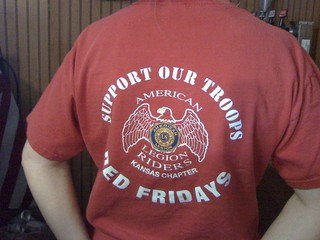"Red T-shirt says, ""Support our troops. Red Fridays. American Legion Riders, Kansas Chapter."""
