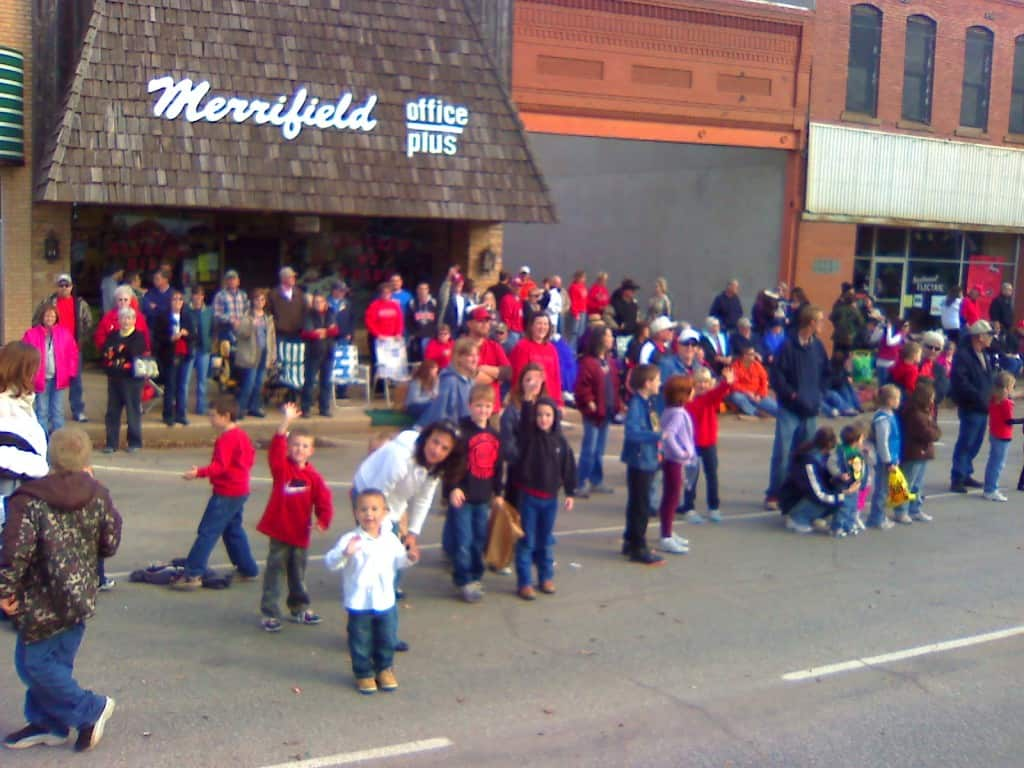 Crowds line Alva, Okla., downtown streets for the annual Homecoming parade.