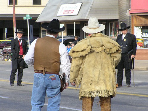 Cowboy re-enactment group the Dog Creek Gunfighters square off for a fight in downtown Alva.