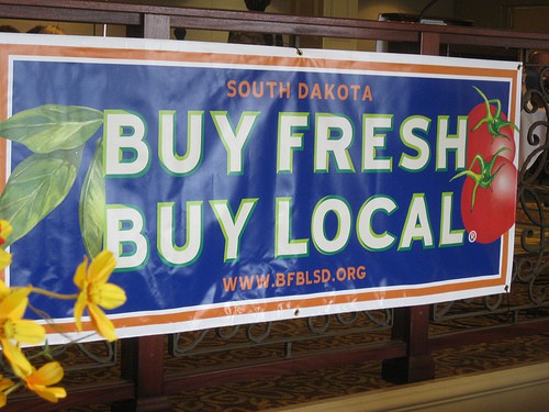 "A banner that reads, ""Buy Fresh, Buy Local"""
