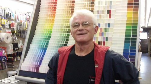 Don stands in front of colorful paint samples.