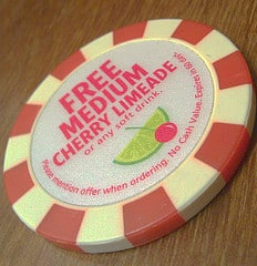 "Poker chip says, ""free medium cherry limeade."""