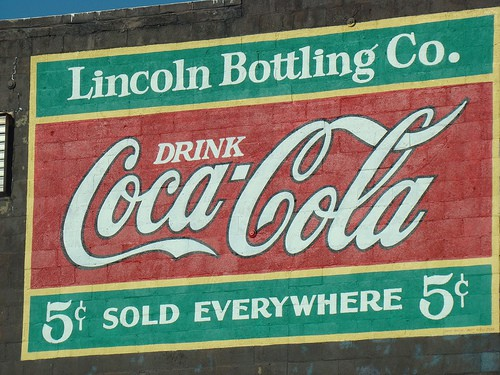 "Mural text says ""Lincoln Bottling Co.  Drink Coca-Cola. 5 cents. Sold everywhere."""
