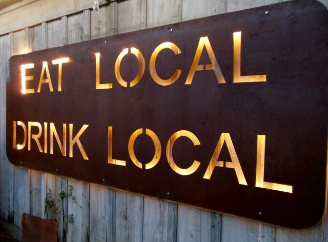 """Eat local, drink local"" sign at Bastrop Brewhouse in Texas. Photo by Sheila Scarborough"