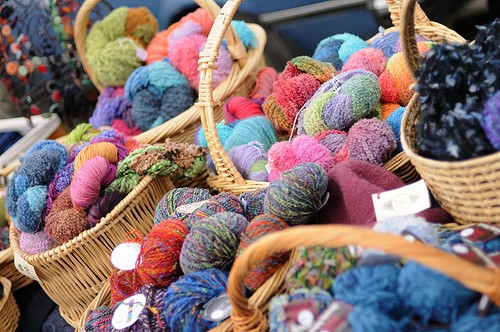 Baskets full of colorful yarn.
