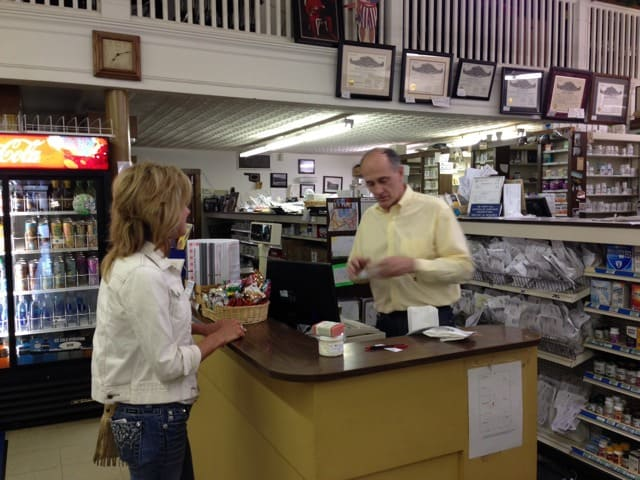 Todd Holder rings up our soaps and lotions. Photo by Becky McCray.