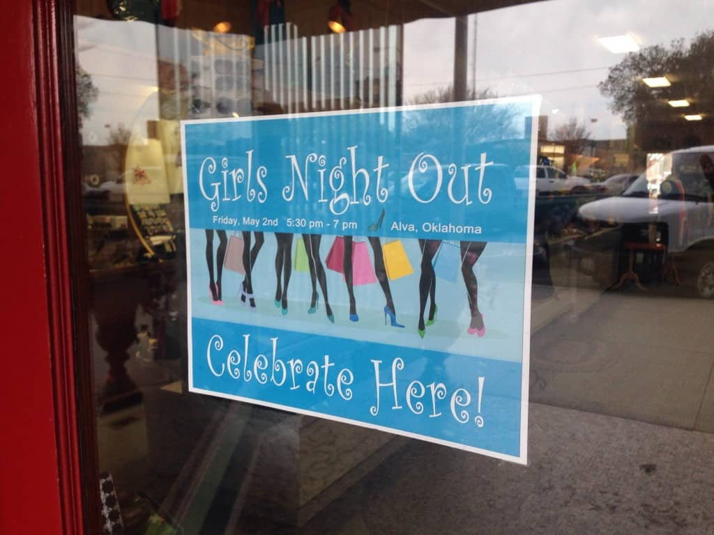 "Poster in a store window for a ""Girls Night Out"" event."
