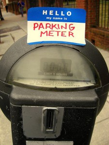 Parking meter with a sticker that says, Hello, my name is Parking Meter. Photo by Jonathan on Flickr.
