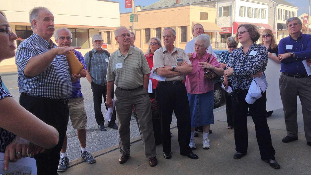 Group taking a walking tour of a downtown.