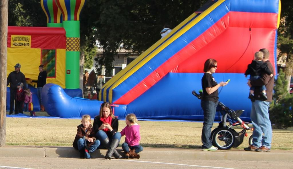 Parents and kids wait for a parade to start in downtown Alva, Oklahoma. Photo by Becky McCray