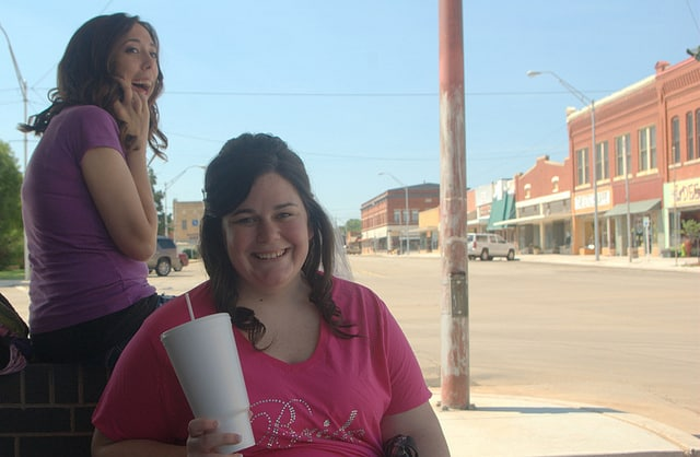 Two young women are all smiles in downtown Alva, Oklahoma.