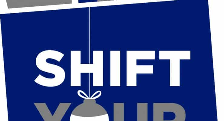 "Shopping bag full of gifts says, ""Shift Your Shopping."""