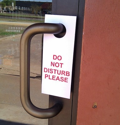 Do not disturb sign on business door. Photo by Becky McCray.