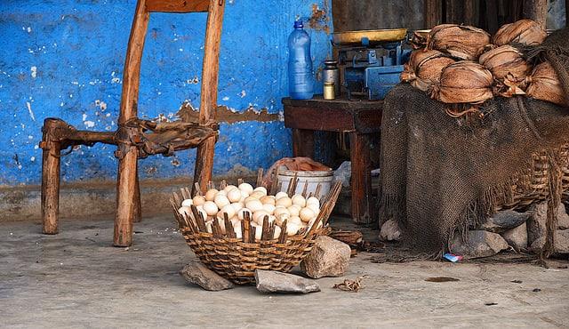 Basket full of eggs for sale.