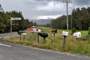 Row of rural mailboxes. Photo by Glen Wright on Flickr.