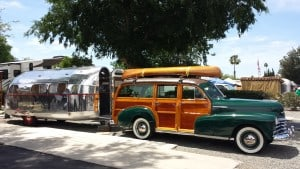 Woodie car and travel trailer.
