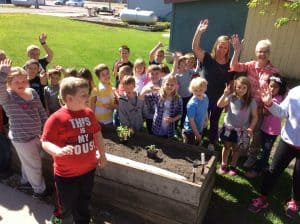 1st & 2nd graders planted at the Care Center. Photo courtesy of Carmen Rath-Wald, North Dakota State University Extension Service