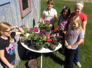 3rd & 4th girls planted flowers while the boys planted peas. Photo courtesy of Carmen Rath-Wald, North Dakota State University Extension Service
