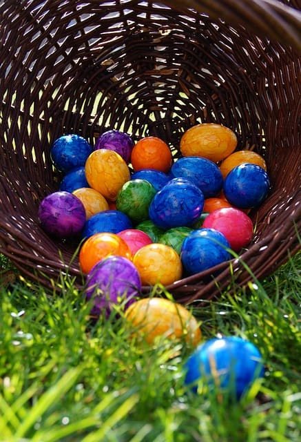 Easter basket overflowing on the lawn