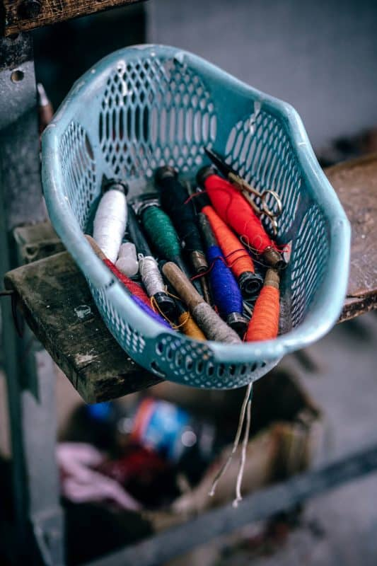 Basket of sewing tools and thread