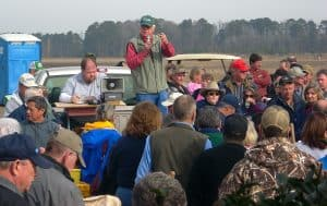 Crowd listening to the auctioneer at a farm auction