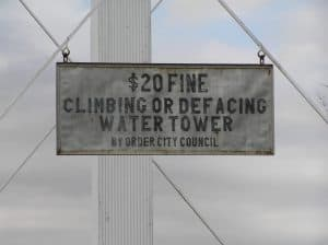 Sign: 20 fine climbing or defacing water tower