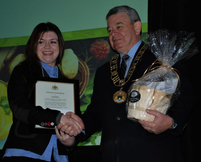 Jordan Stewart receives the Young Entrepreneur Award from Dennis Travale, Mayor of Norfolk County, Ontario.