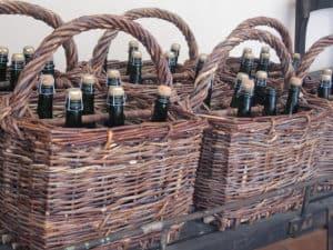 Basket with sparkling wine bottles