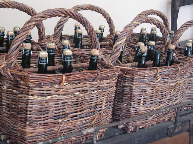 Basket with sparkling wine bottles