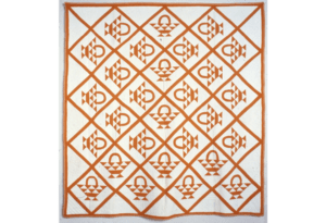 Quilt with repeating basket design