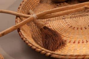 Basket with a tasseled brush