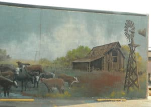 Historic wall painting with cows, barn and windmill