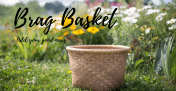 """""""Brag Basket - add your good news"""" over a photo of a basket in a field of flowers"""