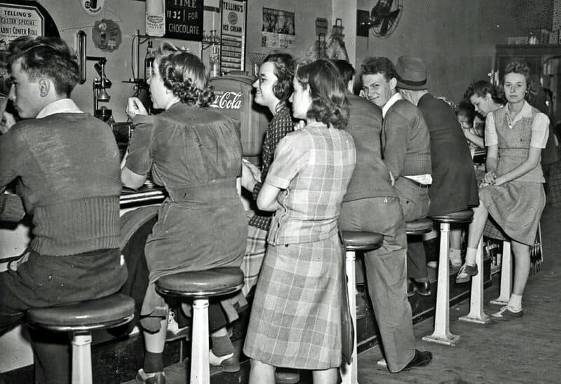 Customers crowd a 1950s soda fountain