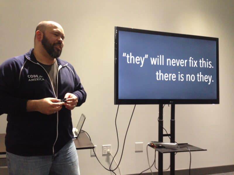 "Carlos Moreno presents a slide saying, ""They will never fix this. There is no they."""