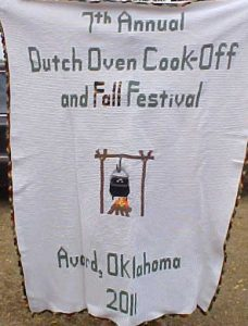 """Handmade afghan showing a dutch oven over a fire, with the words """"7th Annual Dutch Oven Cook-Off and Fall Festival, Avard, Oklahoma"""""""